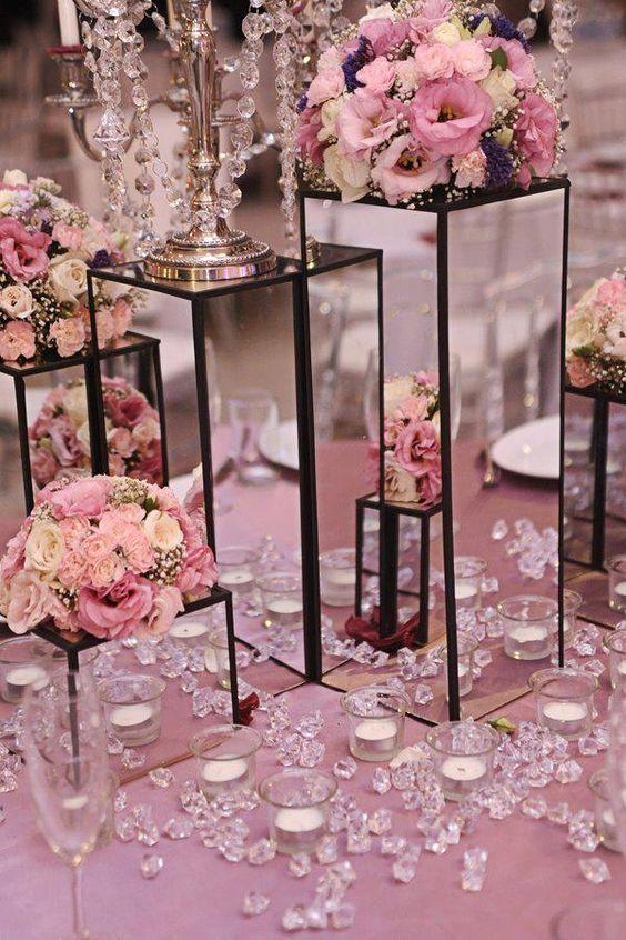 Centros de mesa para xv a os de vidrio ideas para for Decoracion de pared para 15 anos