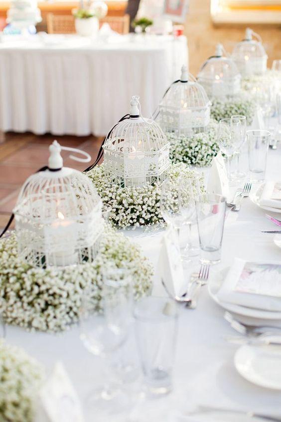 centro de mesa para boda con jaula sencillo