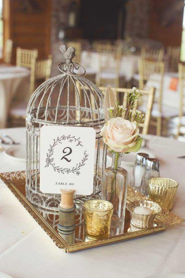 centro de mesa para boda con jaula vintage