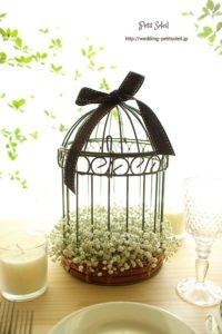 centro de mesa para boda con jaula y nubecita
