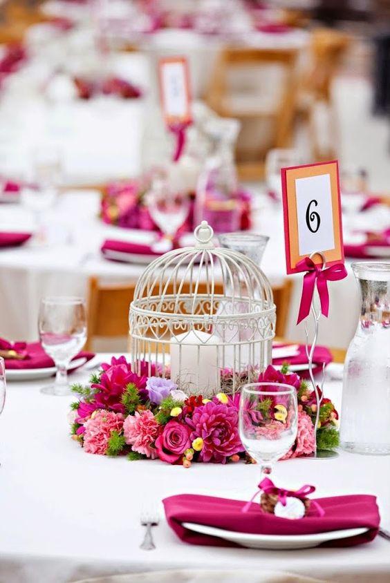 centro de mesa para boda con jaula y velas